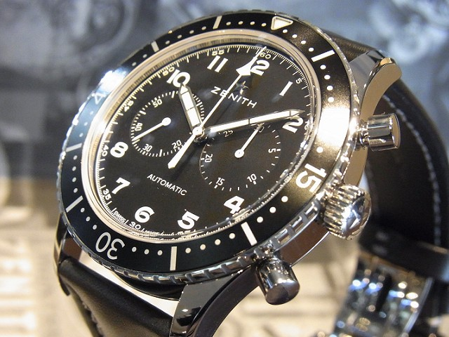 The black dials have contrasting white hour markers and hands.